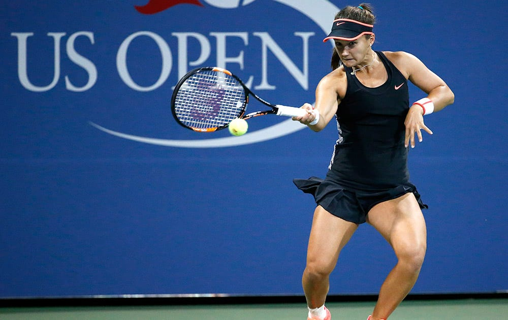 Lauren Davis, of the United Sates, hits a forehand to Ekaterina Makarova, of Russia, during the second round of the US Open tennis tournament in New York.