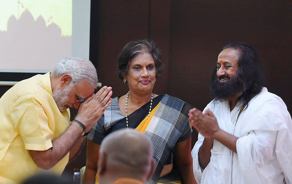 Prime Minister Narendra Modi with former Sri Lankan President Chandrika Kumaratunga and Spiritual leader Sri Sri Ravi Shankar during the conference Samvad, -Global Hindu initiative on conflict avoidance and environment consciousness, in New Delhi.