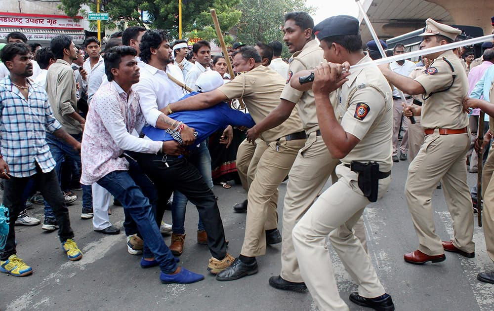 Police lathicharge dalit community members during a protest against Congress MP Vijay Darda and his regional newpaper after it published an article on reservation policy near Lokmat Square in Nagpur, Maharashtra.