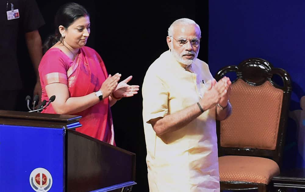 Prime Minister Narendra Modi and HRD Minister Smriti Irani arrive at an interaction with school children, on the eve of Teachers Day at Manekshaw Centre, in New Delhi.