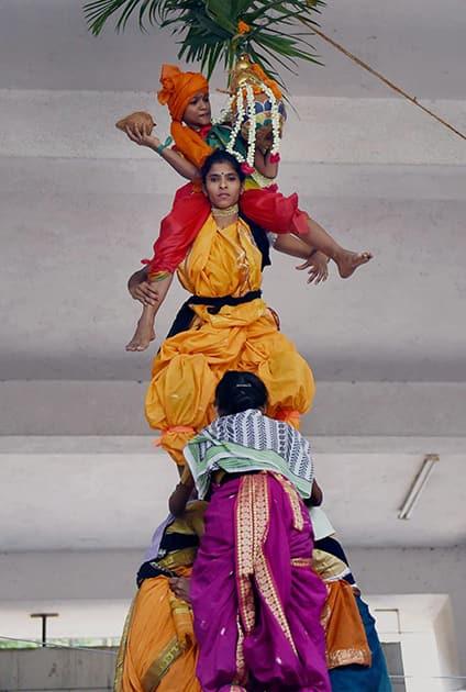 Students from a girls college celebrate Dahi Handi festival in Mumbai.