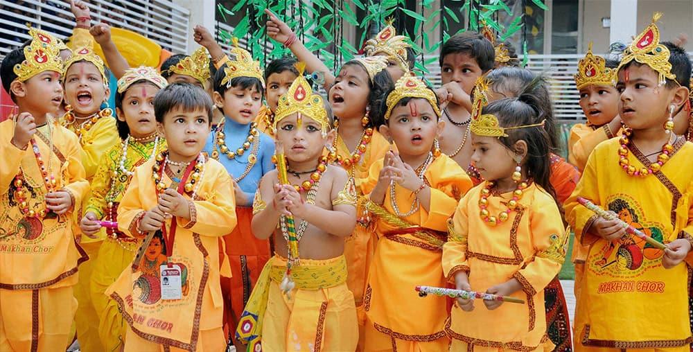 School children dress up as lord Krishna to celebrate Janmashtami at a school in Amritsar.