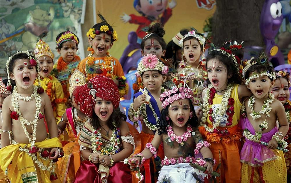 School children dressed as Lord Krishna take part during the Krishna Janmashtami celebrations in Ajmer.