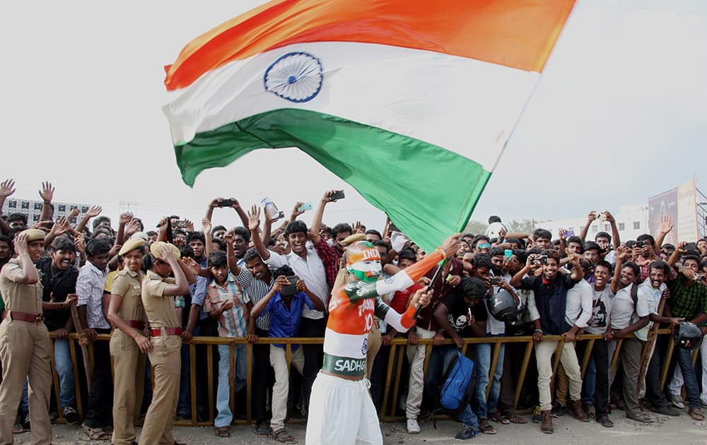 A fan waves a Tricolour during the Isha Gramothsavam, a rural revitalization programme that was attended by cricket legend Sachin Tendulkar in Coimbatore.