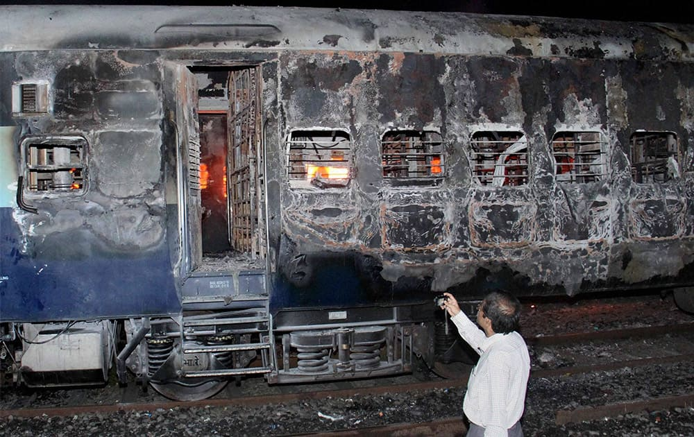 Four coaches each of Dehradun Express and Velakani express, stabled in Kandivali yard, were gutted in fire on Friday mid-night in Mumbai.