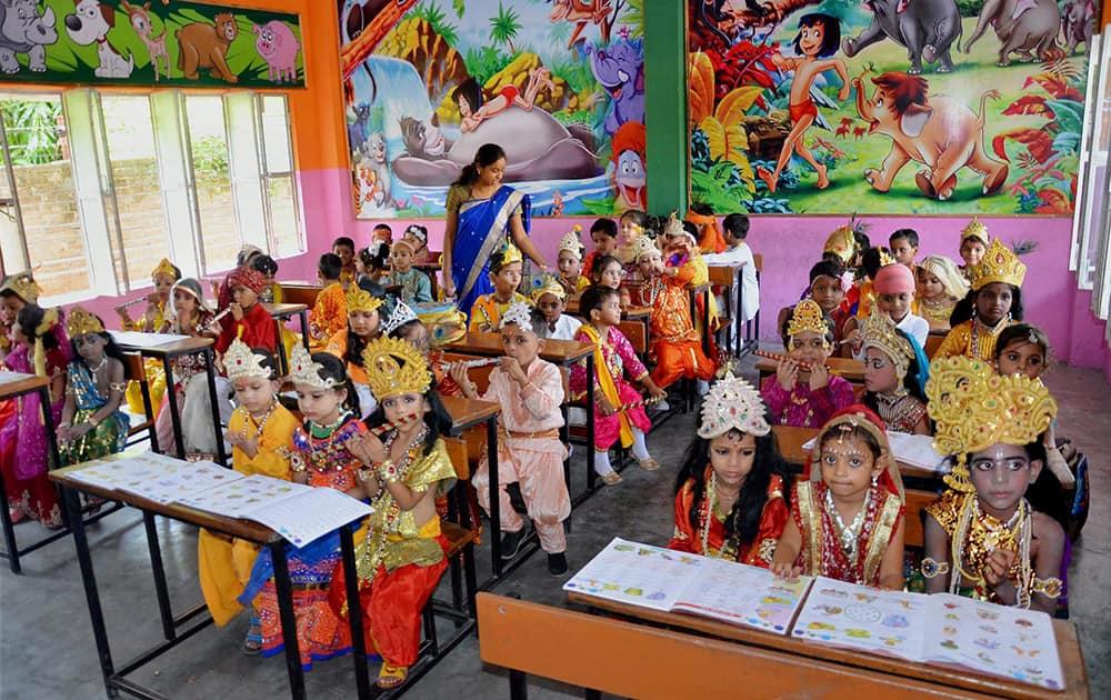 School children dressed up as Lord Krishna during Janmashtami Festival celebrations in Mirzapur.