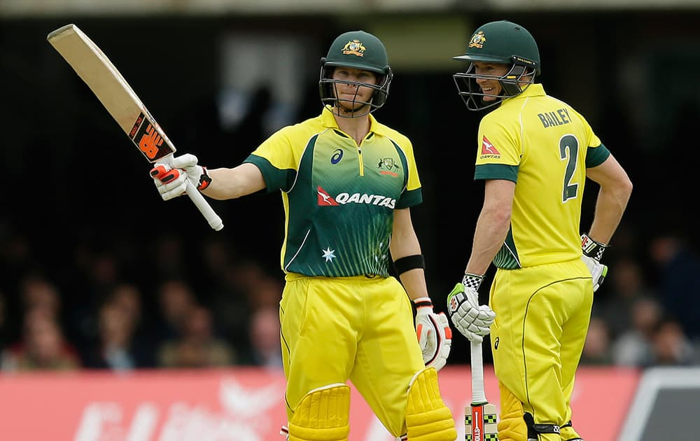 Australia's Steven Smith celebrates making his half century, with Australia's George Bailey during the One Day International cricket match between England and Australia at Lord's Cricket Ground, London.