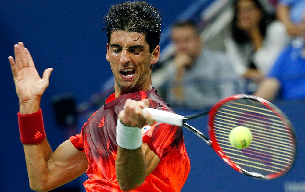 Thomaz Bellucci, of Brazil, returns a shot to Andy Murray, of Britain, during the third round of the U.S. Open tennis tournament in New York.