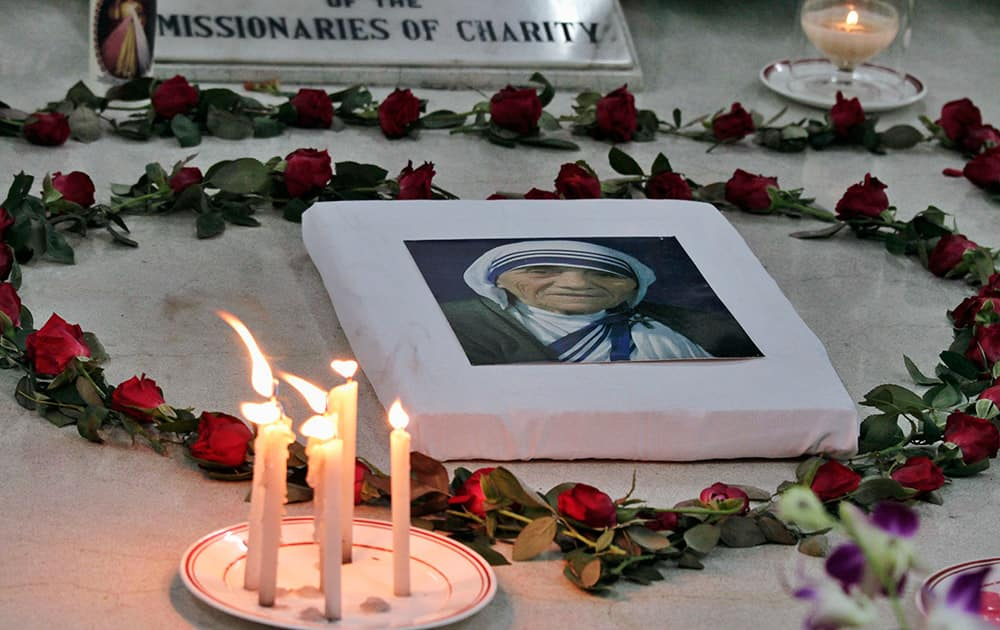 A portrait of Mother Teresa, the founder of the Missionaries of Charity, is placed on her tomb during a prayer ceremony to mark the anniversary of her death in Kolkata, India.