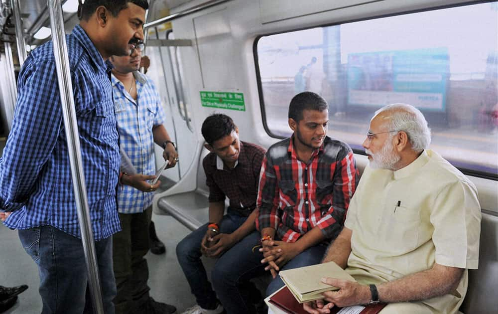 Prime Minister Narendra Modi interacting with co-passengers while travelling by Metro from Janpath to Faridabad.