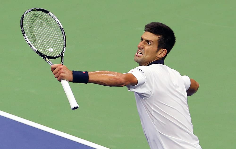 Novak Djokovic, of Serbia, reacts after winning a game in the fourth set during his fourth round match against Roberto Bautista Agut, of Spain, at the U.S. Open tennis tournament in New York.