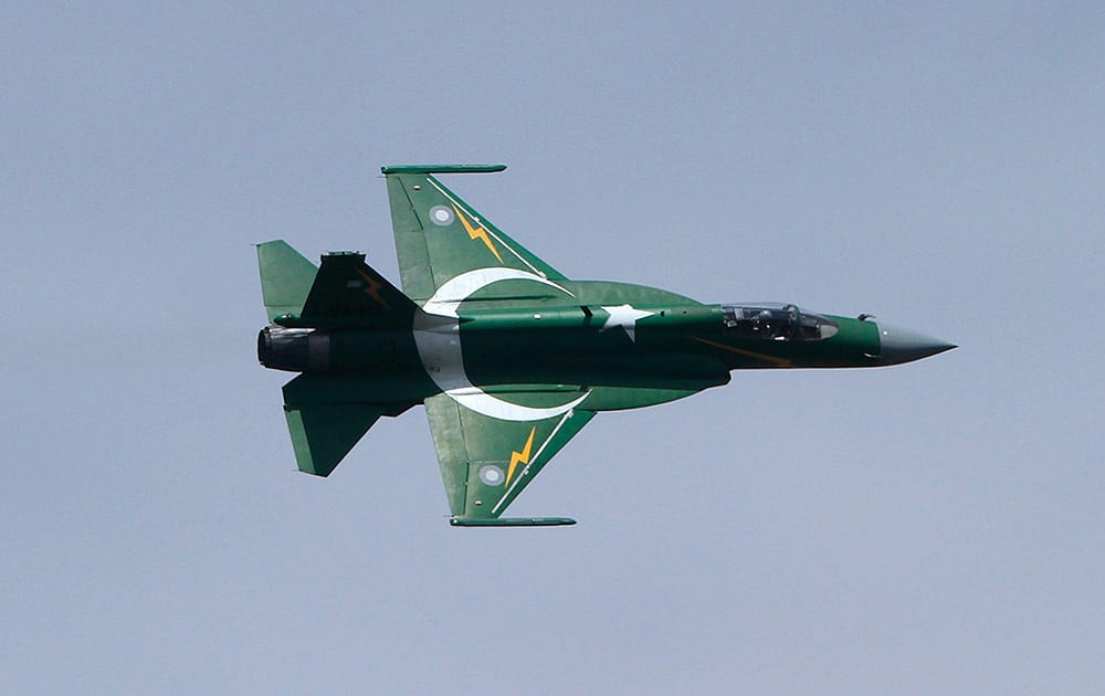 A Pakistani JF-17 fighter aircraft flies in a formation during a ceremony to mark Pakistani Defense Day, in Islamabad.