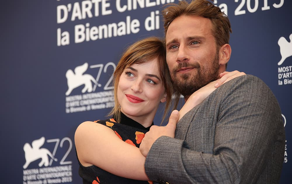 Dakota Johnson and Matthias Schoenaerts pose for photographers at the photo call for the film A Bigger Splash during the 72nd edition of the Venice Film Festival in Venice, Italy.