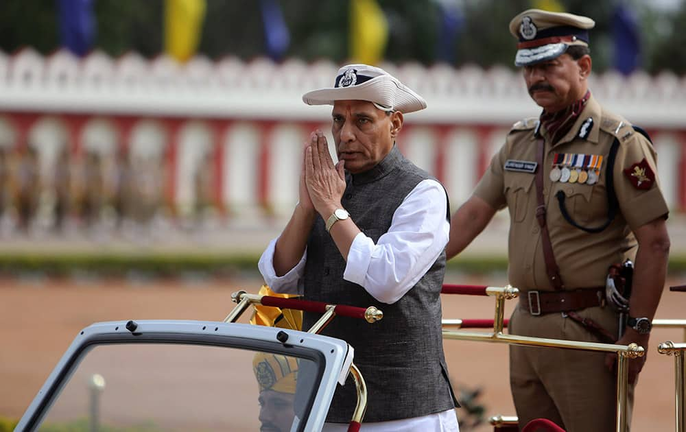 Home Minister Rajnath Singh inspects a guard of honor during a parade ceremony of the Central Industrial Security Force (CISF) at the National Industrial Security Academy (NISA) on the outskirts of Hyderabad.