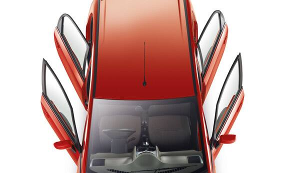 Infinity motif grille, smoked headlamps, Tata signature steering wheel, sporty integrated tailgate spoiler.