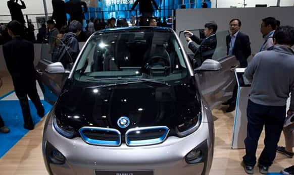 Attendees look at the latest car from BMW at the Shanghai Auto Show in Shanghai.
