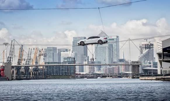 Jaguar XF performs the world's longest high-wire water crossing in the heart of London's business district.