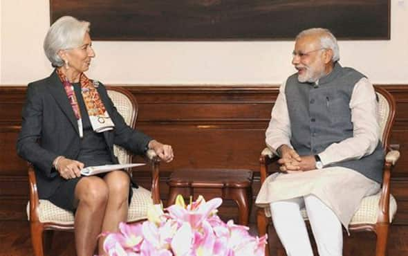 International Monetary fund chief, Christine Lagarde, left, sits with Indian Prime Minister Narendra Modi during their meeting in New Delhi, India, Monday, March 16, 2015.