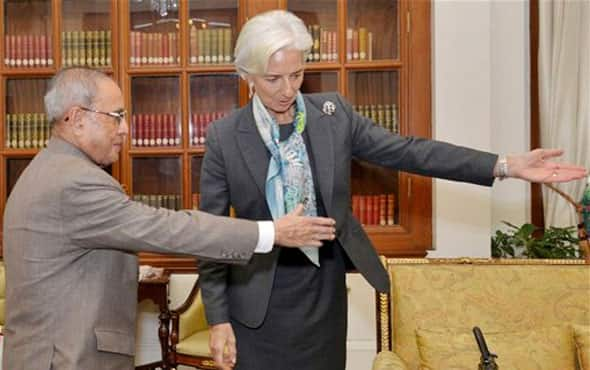 International Monetary fund chief, Christine Lagarde, right and Indian President Pranab Mukherjee gesture during their meeting in New Delhi, India, Monday, March 16, 2015.