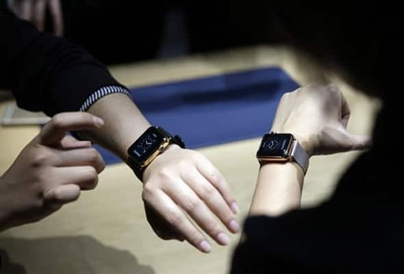 Event attendees get a look at varieties of the new Apple Watch on display in the demo room.