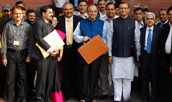 Finance Minister Arun Jaitley, display a briefcase containing union budget for the year 2015-16 as he leaves his office for Parliament to present the union budget in New Delhi.