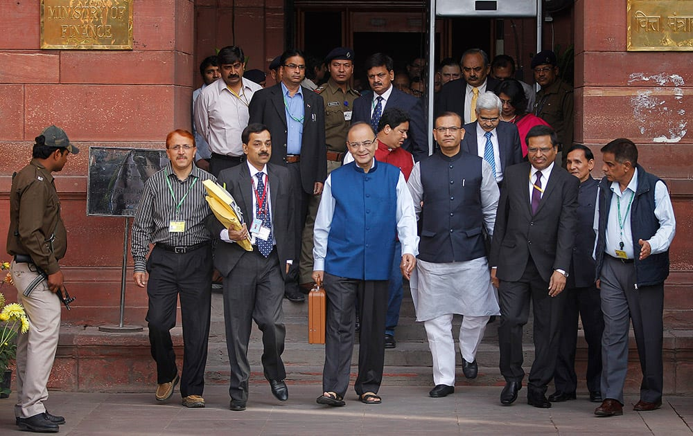 Finance Minister Arun Jaitley, carries a briefcase containing union budget for the year 2015-16 as he leaves his office for Parliament to present the union budget in New Delhi.