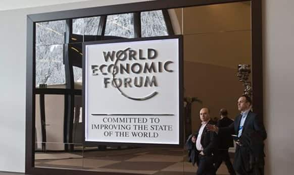 Participants walk in the main entrance hall of the Congress Center the day before the opening of the annual meeting of the World Economic Forum in Davos, Switzerland, Tuesday, Jan. 20, 2015.