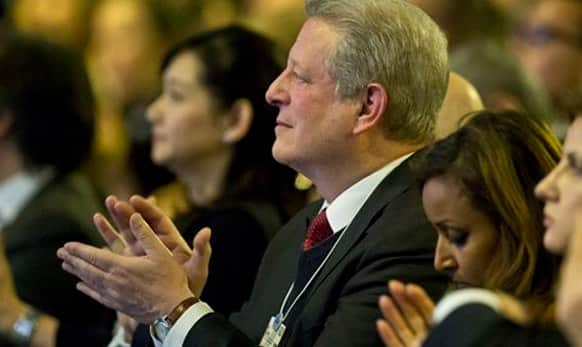 Former U.S Vice President Al Gore applauds during the Cristal Award of the World Economic Forum in Davos, Switzerland, Tuesday, Jan. 20, 2015.