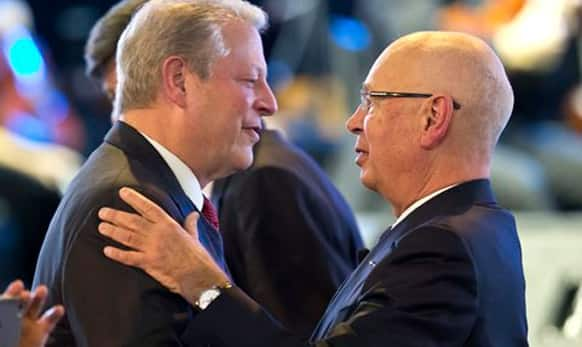 Former U.S Vice President Al Gore, is greeted by President and founder of the World Economic Forum Klaus Schwab during the Cristal Award of the WEF.