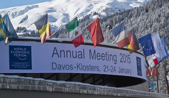 Flags hang on the roof of the Congress Hall were the World Economic Forum will take place in Davos, Switzerland, Monday, Jan. 19, 2015.