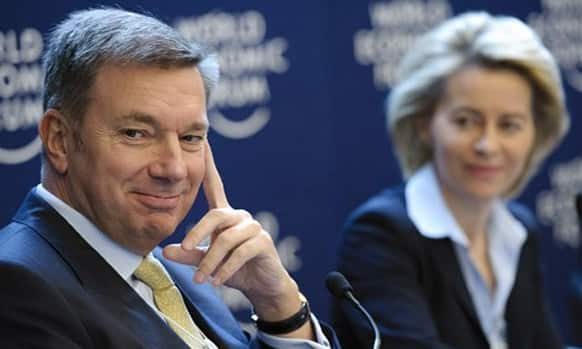 Patrick G. de Maeseneire, left, CEO of the human resources company Adecco Group and German Labor Minister Ursula von der Leyen, right, attend a panel session of the 42nd annual meeting of the World Economic Forum, WEF, in Davos.