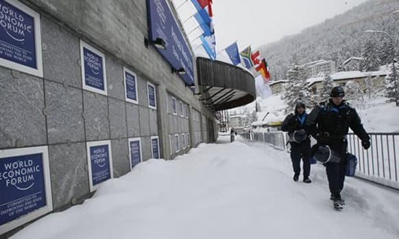 Swiss police officers pass by the Congress Center the day before the opening of the 42nd Annual Meeting of the World Economic Forum, WEF, in Davos, Switzerland.
