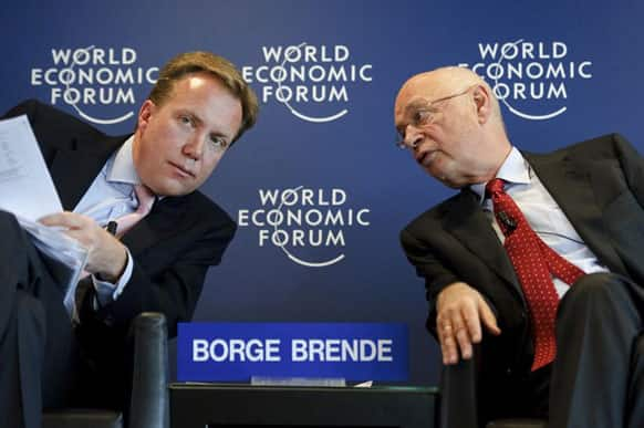 World Economic Forum (WEF) founder and executive chairman Klaus Schwab (R) speaks with Managing Director Borge Brende on January 18, 2012 during a news conference focused World Economic Forum WEF annual meeting at the Forum's headquarters in Cologny, near Geneva.