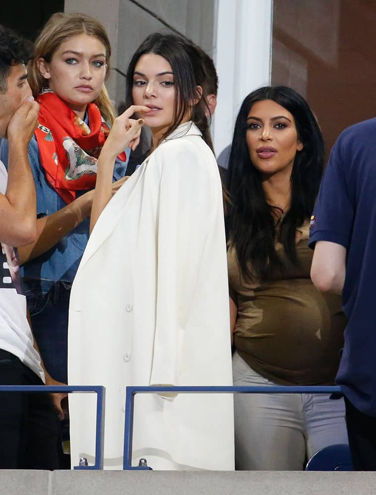 Kendall Jenner, center, and Kim Kardashian, right, arrive to watch a quarterfinal match between Serena Williams and Venus Williams at the U.S. Open tennis tournament.