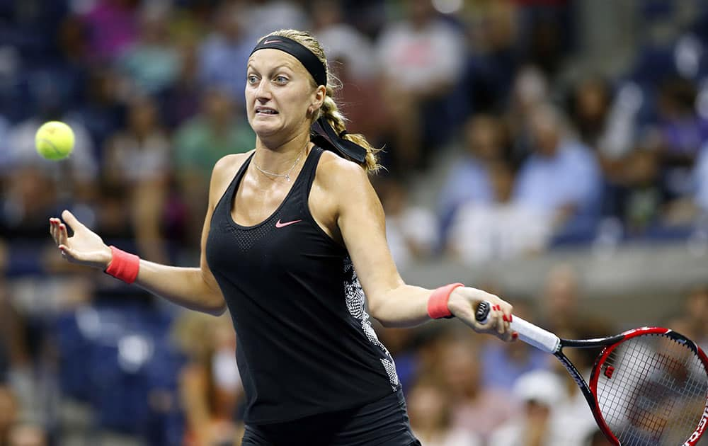 Petra Kvitova, of the Czech Republic, returns the ball to Johanna Konta, of Britain, during their fourth-round match at the US Open tennis tournament in New York.