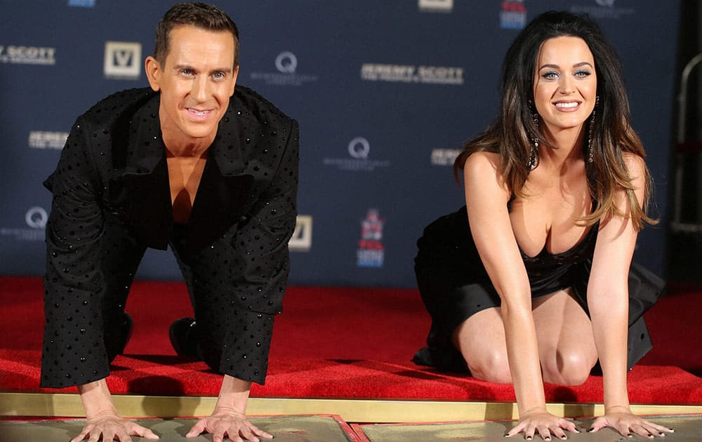 Jeremy Scott and Katy Perry participate in the hand print ceremony at the World Premiere of JEREMY SCOTT: THE PEOPLES DESIGNER, presented by The Vladar Company and Quintessentially at the TCL Chinese Theatre in Hollywood, Calif.
