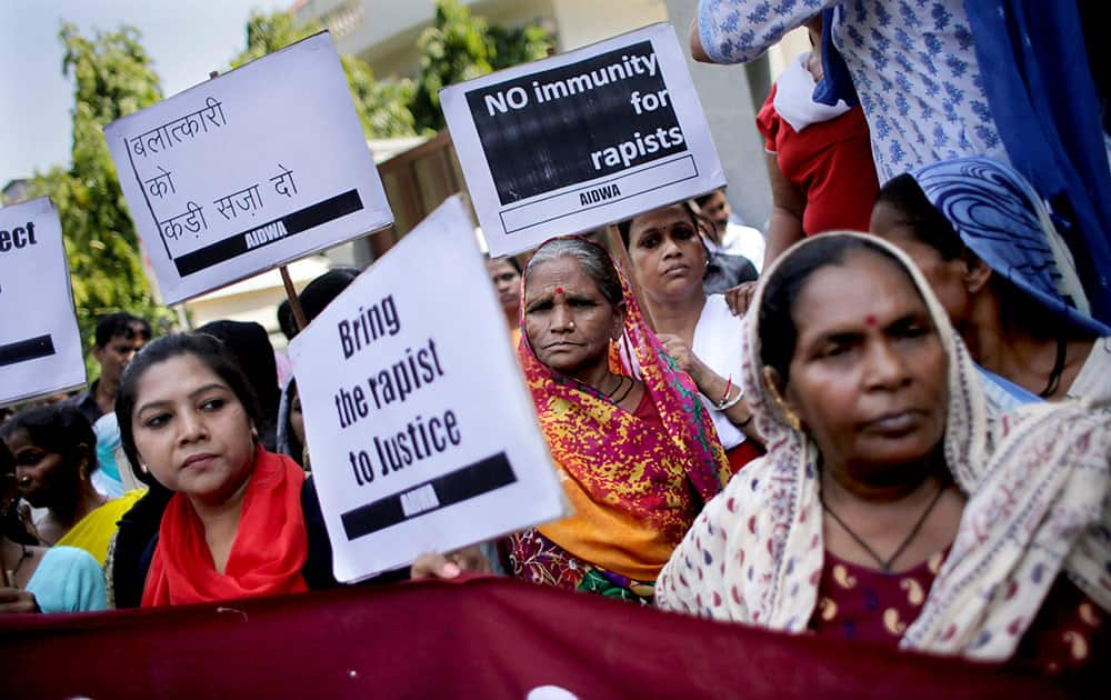 Activists of All India Democratic Women's Association hold placards during a protest outside the Saudi Arabian embassy in New Delhi.