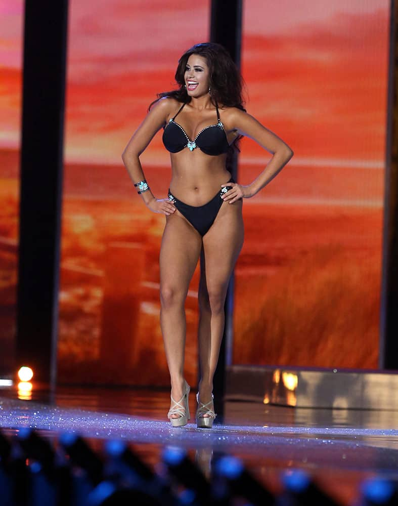 Miss Puerto Rico Destiny Velez contestant competes in swimwear competition during the second night of preliminary for the Miss America pageant at Boardwalk Hall in Atlantic City, NJ.