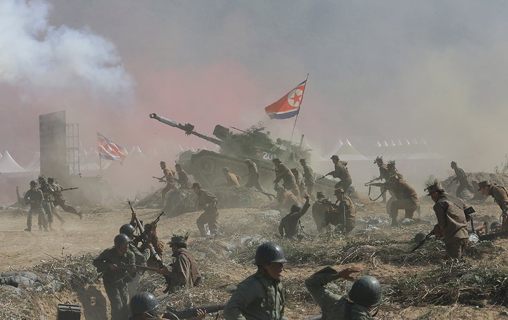 South Korean and US Army soldiers perform a fighting between United Nations forces and North Korean army soldiers during Naktong River Battle re-enactment in Waegwan, South Korea.