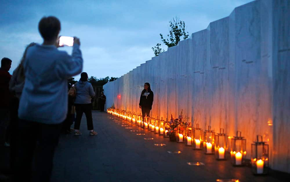 Candles in memory of the passengers and crew of Flight 93, line the Wall of Names at the Flight 93 National Memorial in Shanksville, Pa.