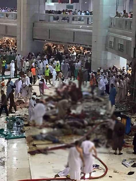 Pilgrims and first responders gather at the site of a crane collapse that killed dozens inside the Grand Mosque in Mecca, Saudi Arabia.