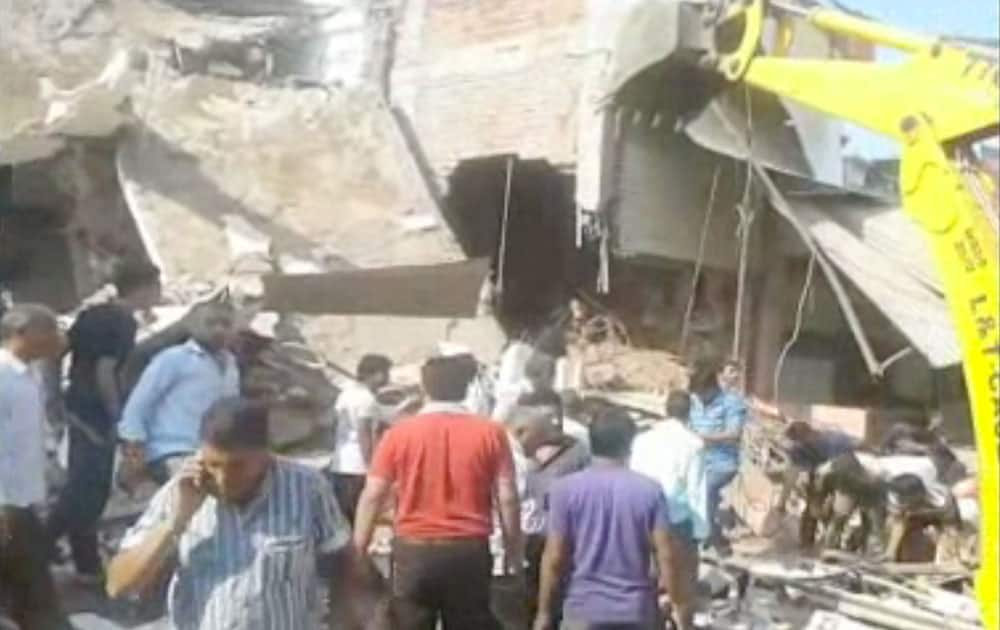 People help at the scene after an explosion at a restaurant, in Petlawad, India.