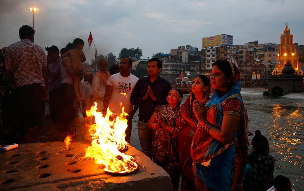 Indian devotees pray on the banks of the Godavari River during Kumbh Mela, or Pitcher Festival, in Nasik, India.