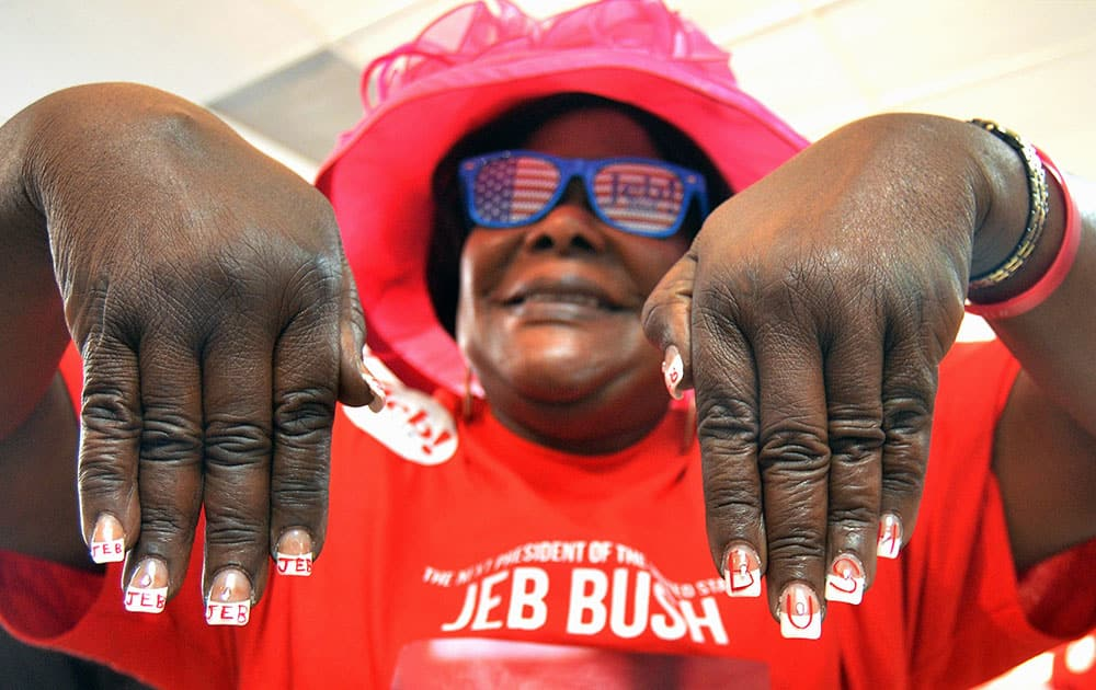 Lucy Orlando shows her Jeb Bush manicure during Republican presidential candidate and former Florida Gov. Jeb Bush's opening of his Miami campaign office.