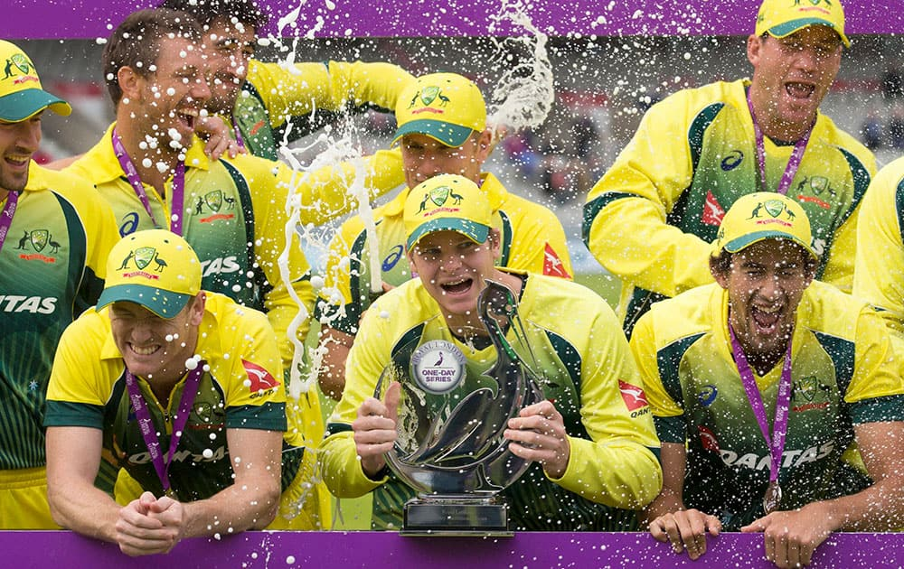 Australias captian Steven Smith, centre, celebrates with teammates after winning the One Day International series between England and Australia at Old Trafford cricket ground in Manchester, England.