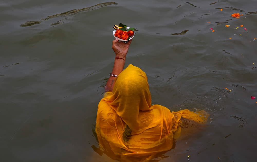 An Indian woman devotee prays after a holy dip on the second 'shahi snaan' or royal bath in the river Godavari during the ongoing Kumbh Mela or Pitcher Festival, in Nasik, India.