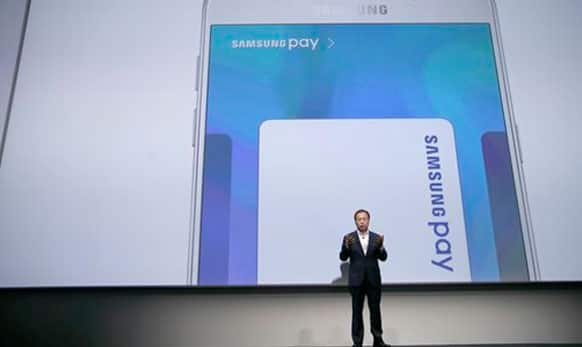 JK Shin, president and CEO of Samsung Electronics, talks about Samsung Pay during a presentation.