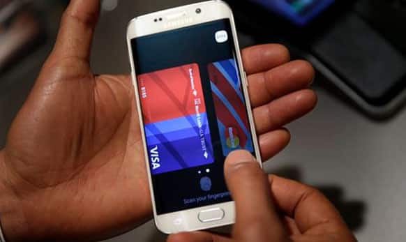 A Samsung employee demonstrates Samsung Pay using a Galaxy S6 Edge Plus in New York.