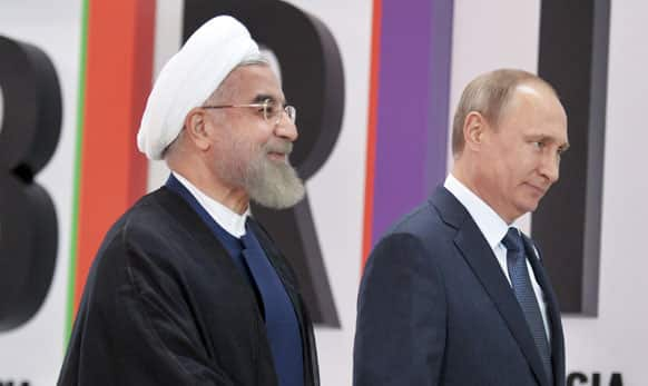 Russian President Vladimir Putin, right, and Iran's President Hassan Rouhani.