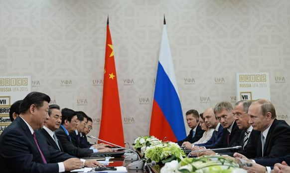 Russian President Vladimir Putin, right, and Chinese President Xi Jinping, left, attend talks during a BRICS summit in Ufa.